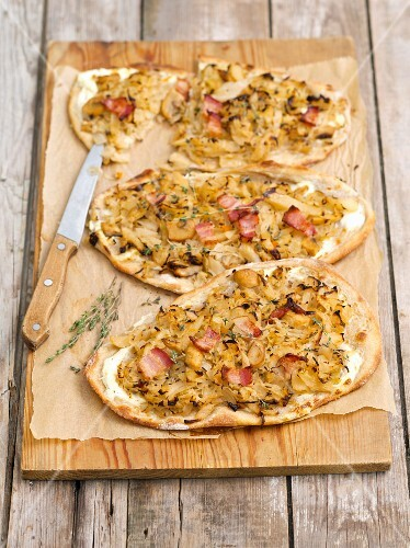 Tarte flambée with white cabbage, onions and Pancetta