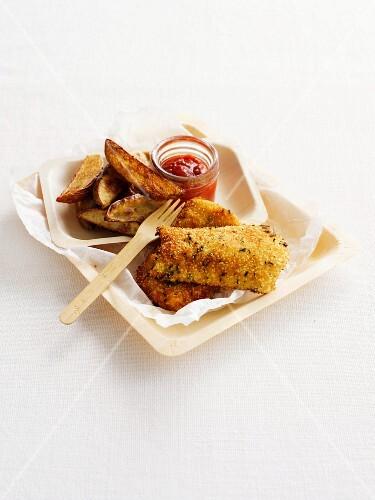 Crispy coated fish with potato wedges