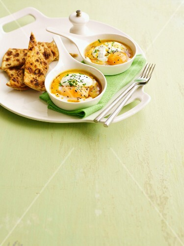 Curried eggs with garlic and naan bread