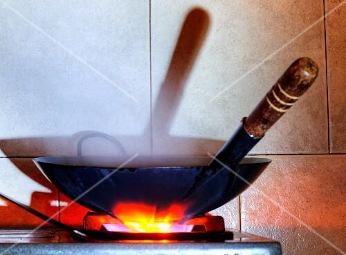 A wok on a gas cooker