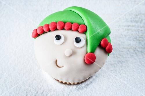 A Christmas elf cupcake