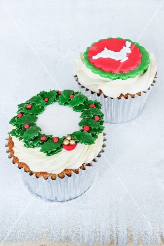 Lemon and chocolate cupcakes decorated with a wreath of holly and a reindeer