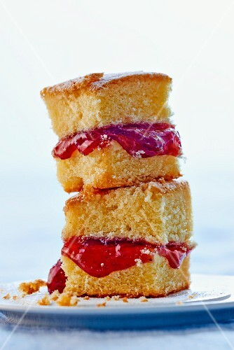 A stack of cake slices with strawberry jam