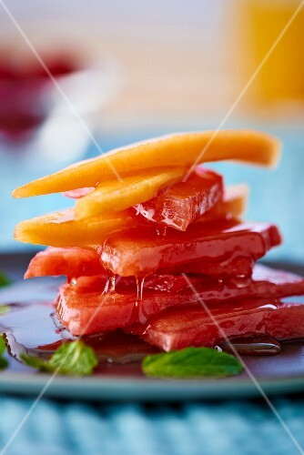 Melon pieces with mint syrup