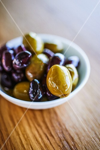 Marinated olives in a small bowl