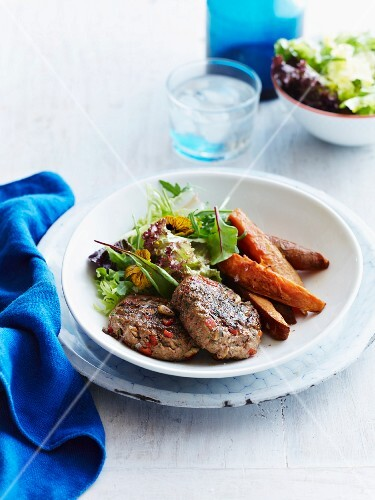 Turkey patties with sweet potatoes and a mixed leaf salad