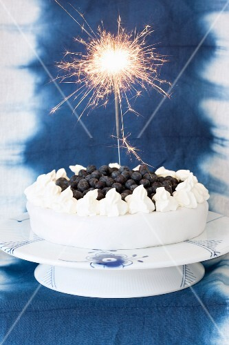A marzipan cake with blueberries and vanilla cream