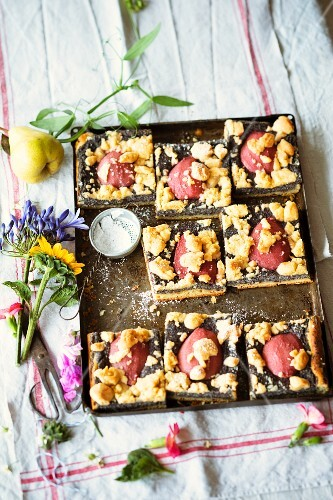 Poppyseed tray bake cake with red wine pears and crumbles