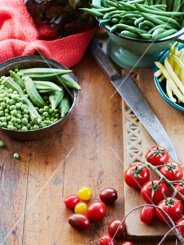 An arrangement of fresh vine tomatoes, peas and okra