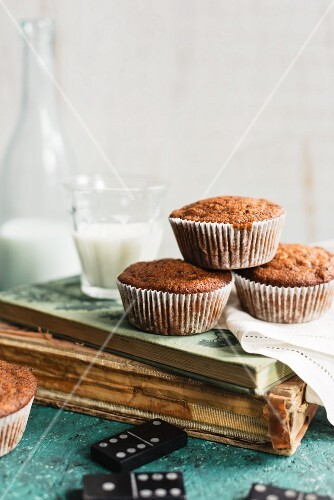 Muffins and milk on an old book