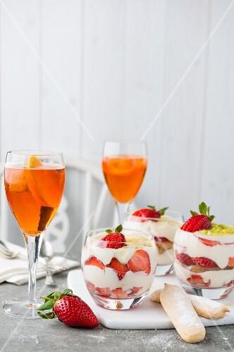 Strawberry tiramisu and orange cocktails