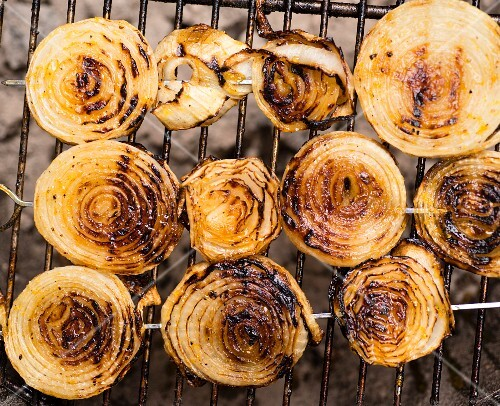 Grilled onions on a barbecue