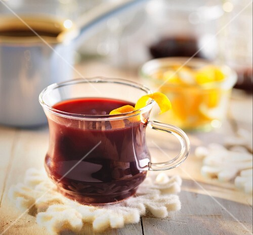 Mulled wine with lemon zest in a glass cup