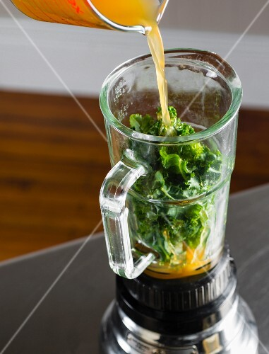 A green kale smoothie being made