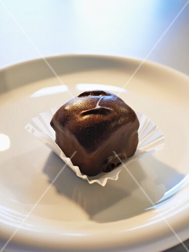 A bite-sized brownie with dark chocolate glaze