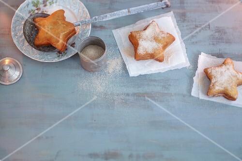 Star-shaped doughnuts with icing sugar