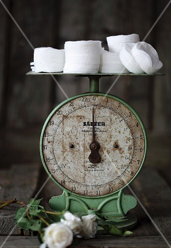 White cotton pads on an old pair of kitchen scales