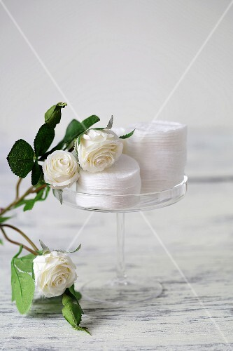 Cotton pads and white roses