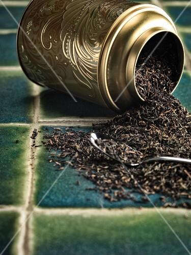 Assam tea leaves in an overturned tin