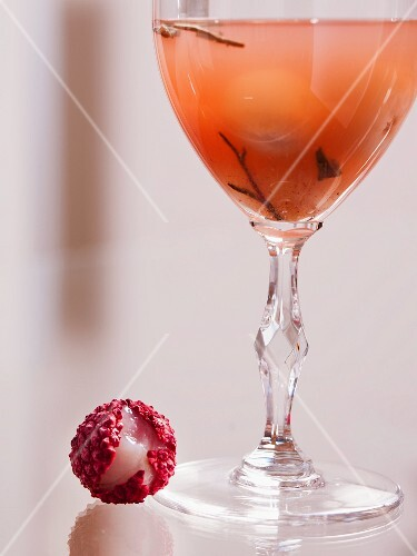 A white tea cocktail with rum and lychees