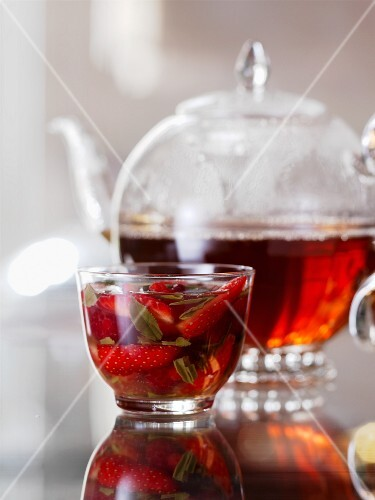 Tea with syrup and strawberries