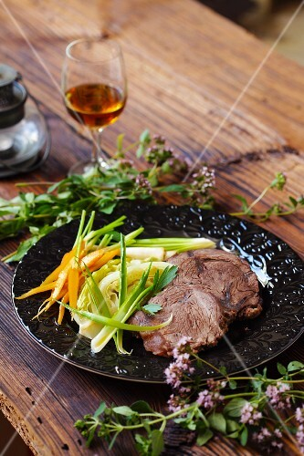 Beef with vegetables on a wooden table
