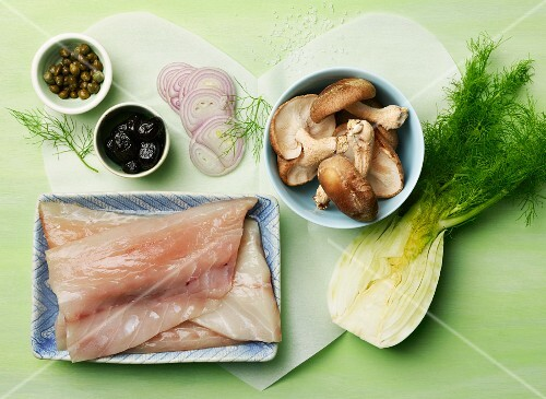 Ingredients for fish en papillote; fennel, striped bass, Shiitake mushrooms
