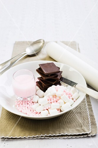 Chocolate, marshmallows, sugar pearls and pink icing