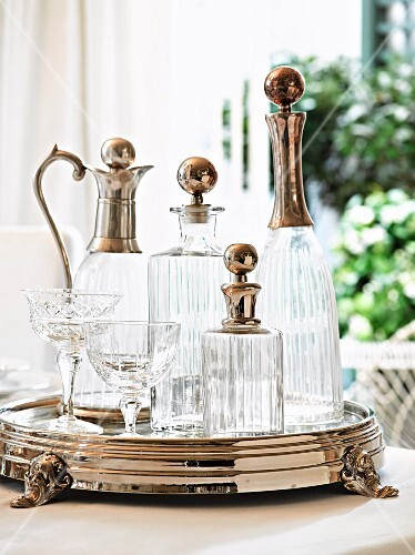 Elegant carafes and crystal glasses on silver tray