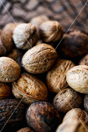 Four walnuts in a basket (close-up)