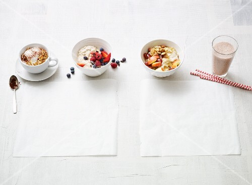 Oat shake and various types of muesli for a vegan breakfast