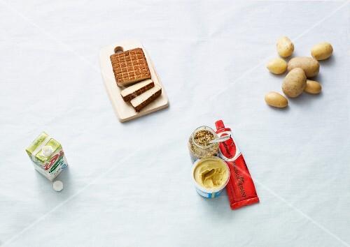 Ingredients for vegan dishes: tofu, soya milk, potatoes and mustard