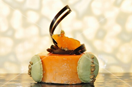 Orange cake with pistachio macaroon and a chocolate spiral
