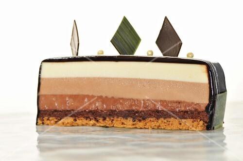 A three-layered chocolate cake with chocolate glaze