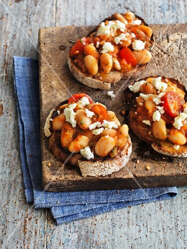 Greek toast with beans, feta cheese and tomatoes