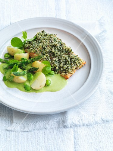 Salmon fillet with a herb crust, potatoes, asparagus and pea sauce