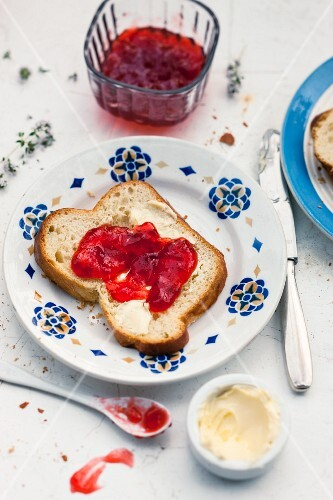 Strawberry jelly with thyme on a slice of white bread