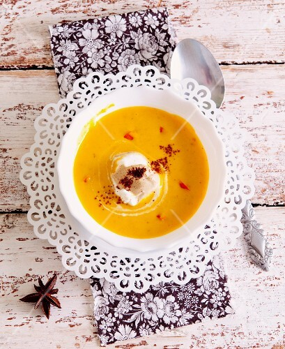 Sweet pumpkin soup with star anise and cinnamon cream