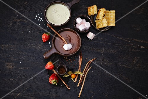 Chocolate fondue with waffles, marshmallows and fruit