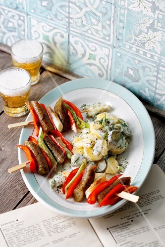 Tofu sausage skewers with peppers and spring onions