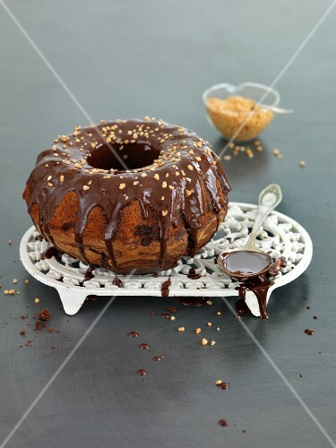 Marble cake with chocolate glaze and nuts