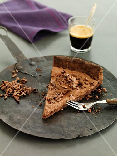 A slice of chocolate mousse cake with coffee