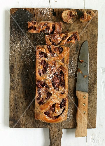 Plum bread on a chopping board