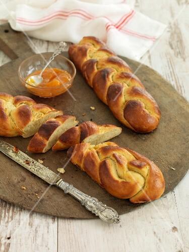 Sweet yeast bread plaits with yellow plum glaze