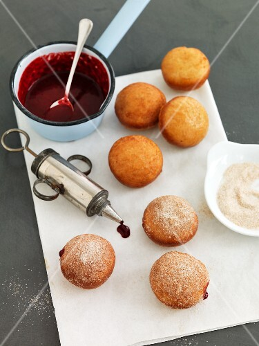 Stuffed cherry doughnuts with cinnamon sugar
