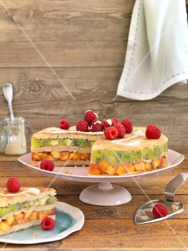 A pancake cake with kiwis, nectarines and raspberries
