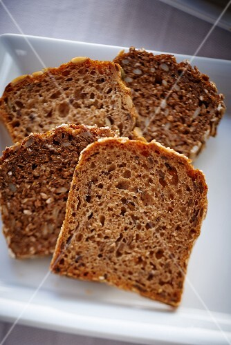 Four slices of wholemeal bread on a plate