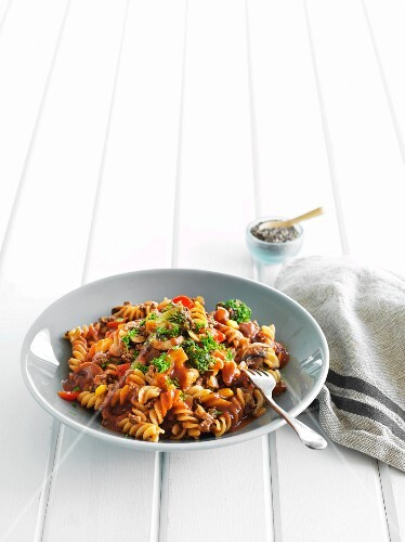 Fusilli pasta with vegetables, mushrooms and parsley