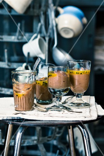 Mousse au chocolat with passion fruit sauce