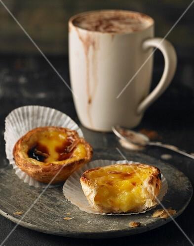 Pastel de Nata (Portuguese custard tarts) with a mug of coffee